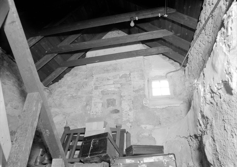 Interior view of Corsindae House showing fireplace in attic of old part of house.