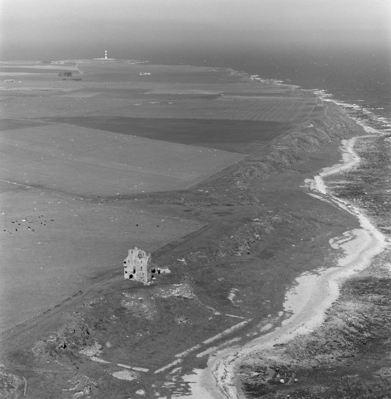 Oblique aerial view of Ballone Castle and Tarbatness lighthouse in the distance.