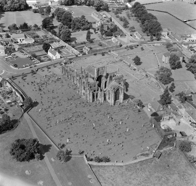Oblique aerial view centred on Melrose Abbey.