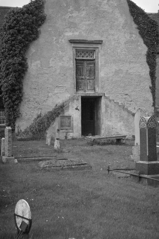 View of Kiltearn Parish Church showing stairs and door.