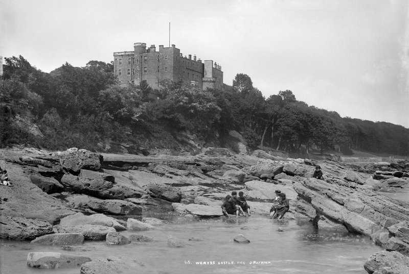 View of Wemyss Castle showing children paddling in sea
