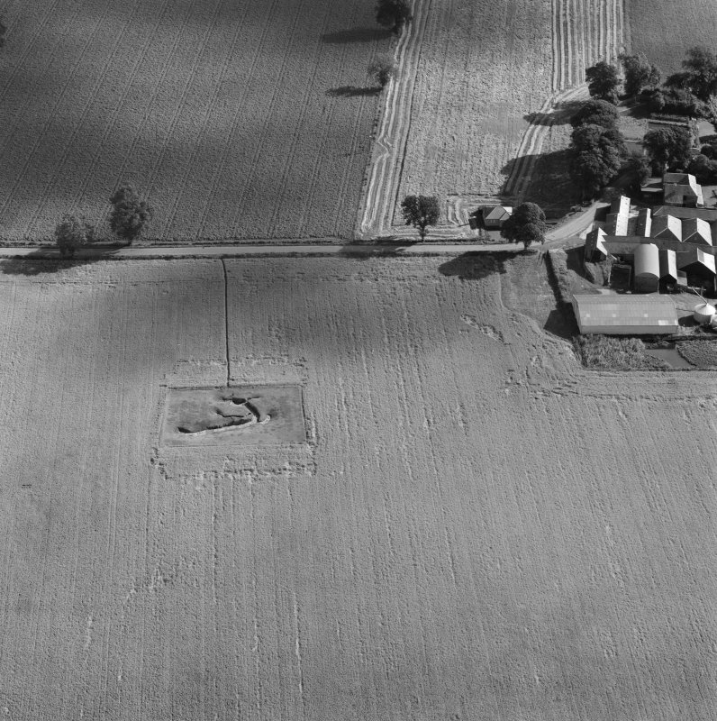 Oblique aerial view of the souterrain at Carlungie with the farmstead adjacent.