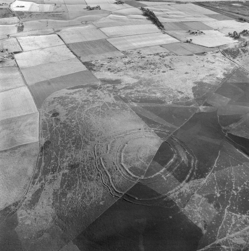 Oblique aerial view centred on the remains of the fort at Brown Caterthun.