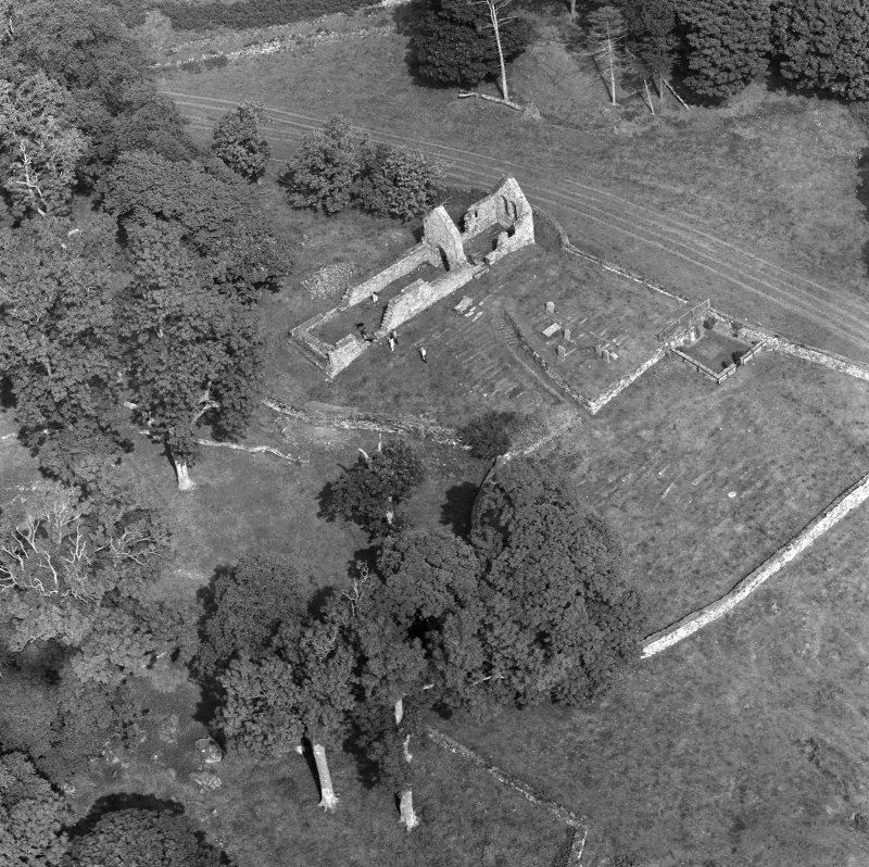 Oblique aerial view centred on the remains of St Blane's Church and burial ground, Bute, taken from the SW.