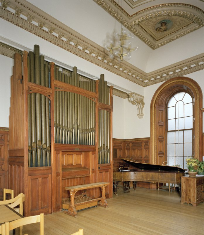 Interior. Detail of Chapel pipe organ and piano.