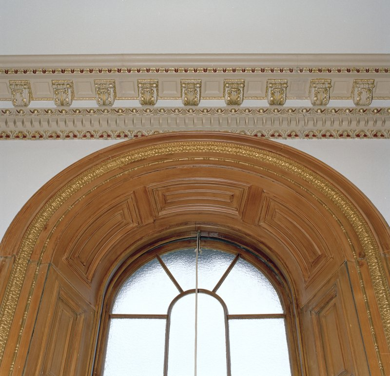 Detail of cornice and window frame.