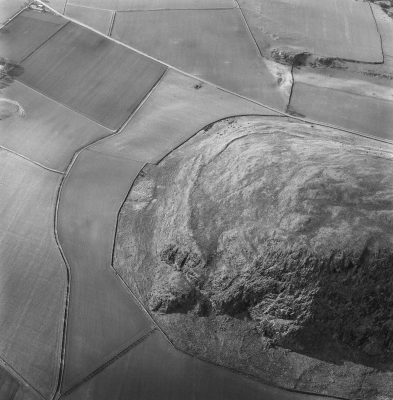 Oblique aerial view of the remains of Traprain Law showing the W part of the fort.