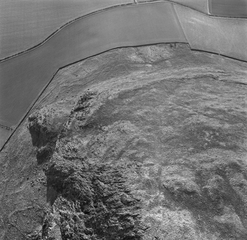 Oblique aerial view of the remains of Traprain Law showing the SW part of the fort.