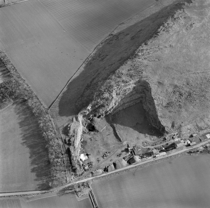 Oblique aerial view of the remains of Traprain Law showing the NE part of the fort and the quarry.