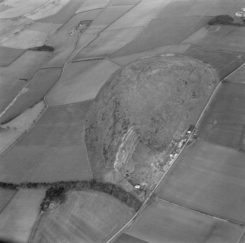 Oblique aerial view of the remains of Traprain Law fort, looking SW.