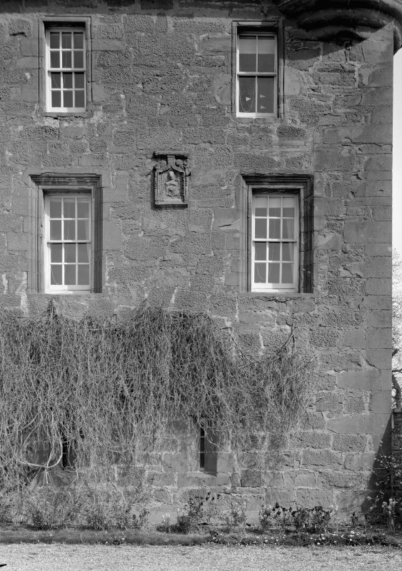 Detail of Gardyne Castle from SW showing windows and armorial panel.