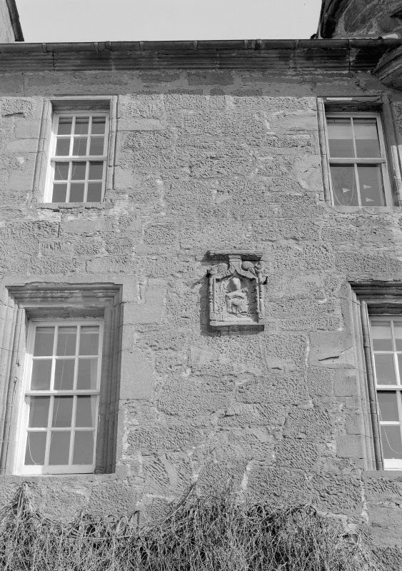 Detail of Gardyne Castle showing heraldic panel and windows from S.