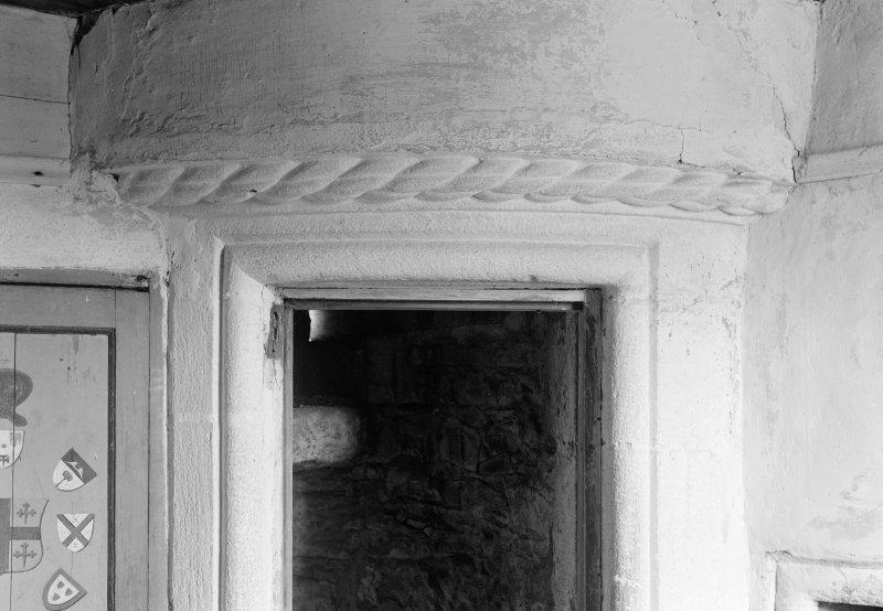 Interior view showing detail of cable moulding over door of turret on top floor, Gardyne Castle.