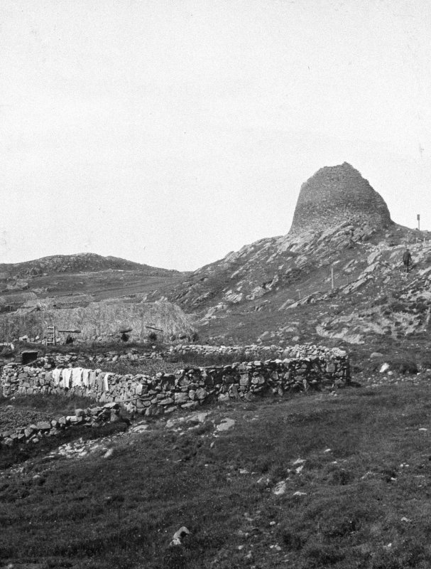 View of broch from east.  Blackhouse is partially visible. Copied from a photograph album of M Curle,1931-5.