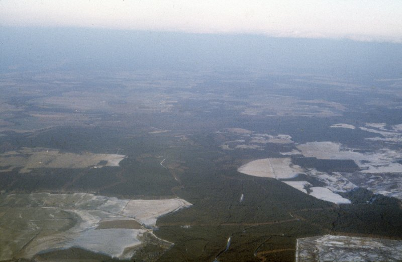 General oblique aerial view over Assich forest