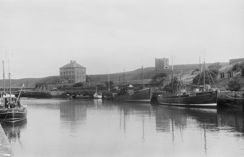 General view of Gunsgreen House and dovecot and Eyemouth harbour.