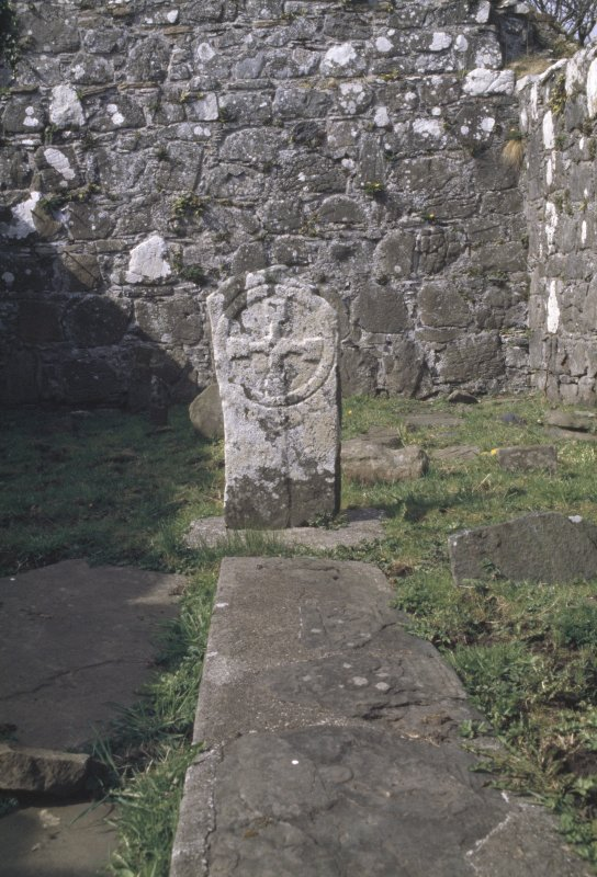 Eigg, Kildonnan, St Donnan's Church. View of grave-slab and headstone within church interior.