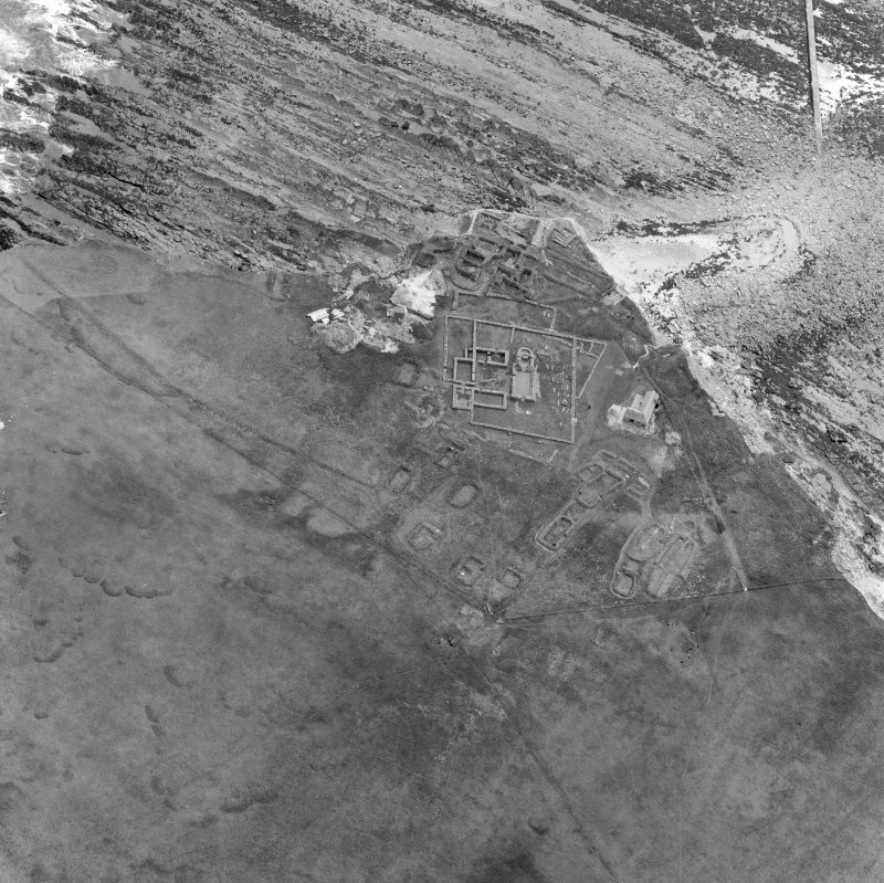 Oblique aerial view of the chapel and settlement at Brough of Birsay.