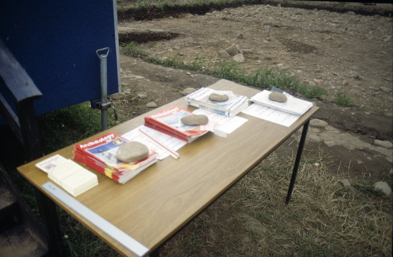 Table showing leaflets for tours at an excavation, probably at Home Rose