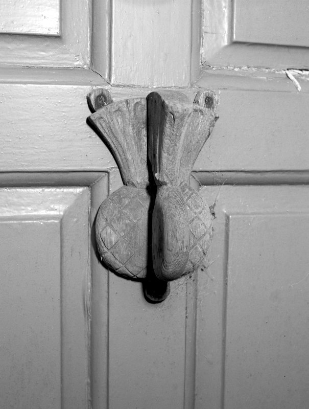 Detail of door knocker to main door.