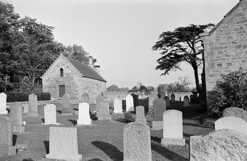 General view of the tithe barn and churchyard, Foulden, from W.