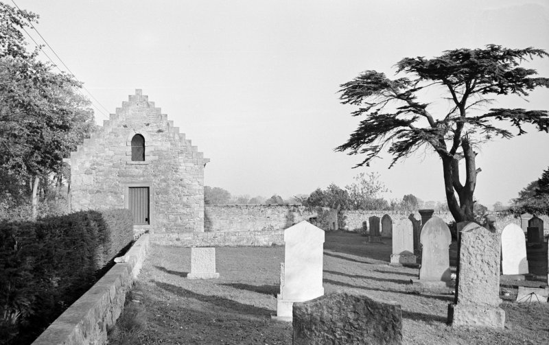 General view of the tithe barn and churchyard, Foulden.