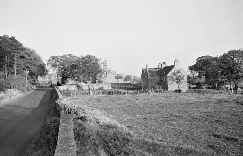 Distant view of the tithe bar, church and manse, Foulden.