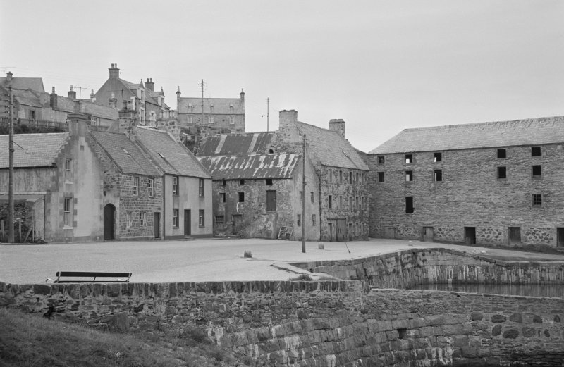 General view of buildings in Shorehead harbour, Portsoy, including Corf Warehouse.