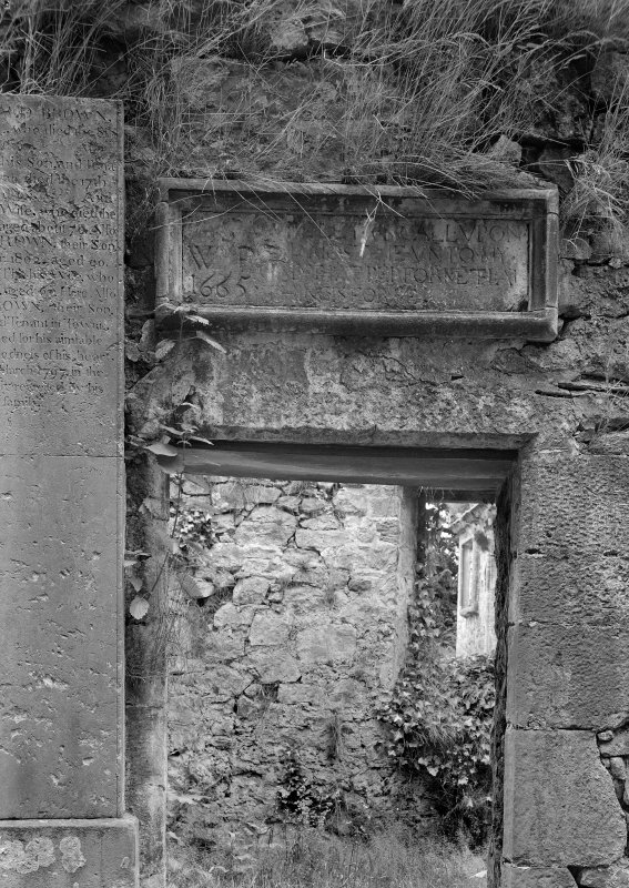 Detail of entrance doorway and inscription in S wall of main block, Glencorse Old Parish Church.