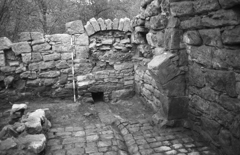 Craignethan Castle Excavations 1984 Frame 24 - South-east corner of tower showing blocked window and drain in floor - from west