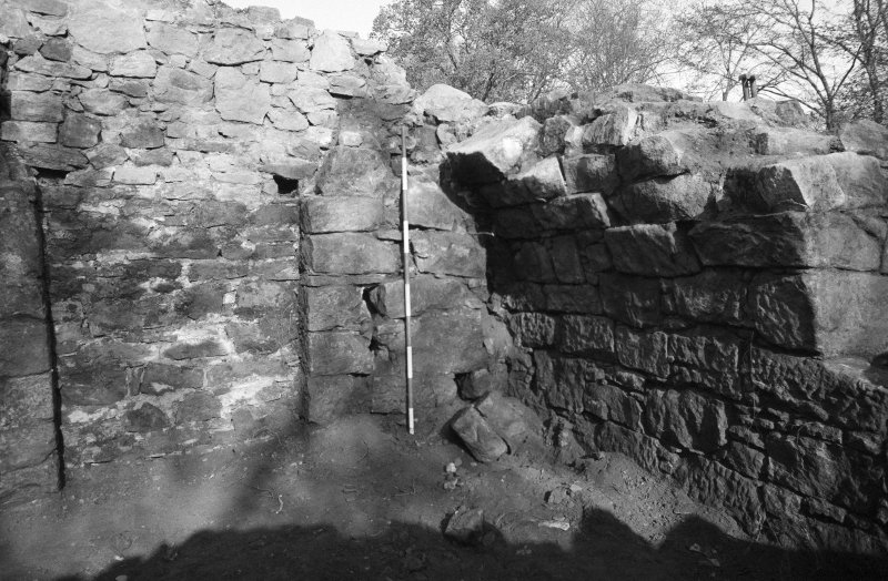 Craignethan Castle Excavations 1984 Frame 7 - North-west corner of tower showing blocked doorway in west wall and springers of arched basement - from east