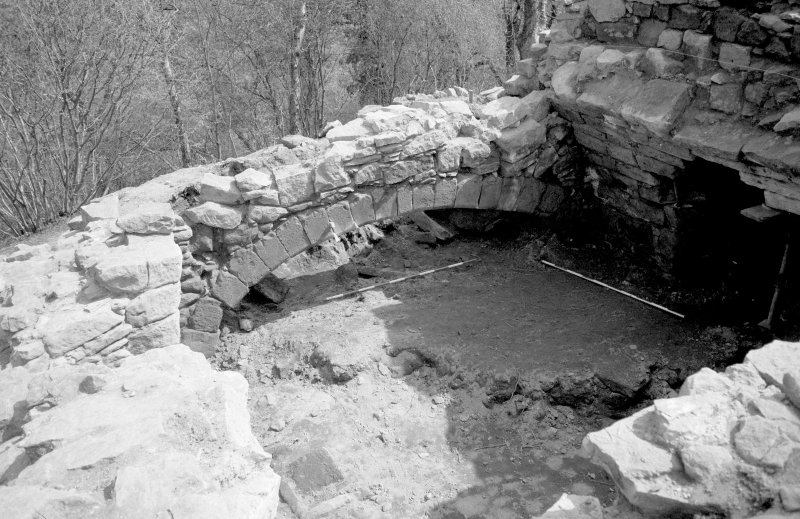 Craignethan Castle Excavations 1984 Frame 34 - East side of basement showing kitchen fireplace - from north-east