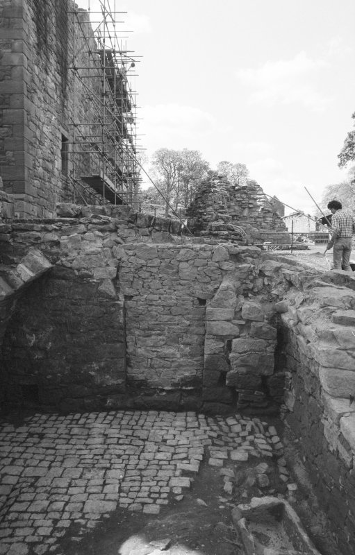 Craignethan Castle Excavations 1984 Frame 15 - The basement, showing its floor fully uncovered. Note the blocked doorway in the west wall - from east