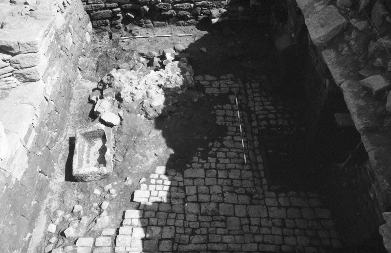 Craignethan Castle Excavations 1984 Frame 11 - The floor of the basement, showing cobbles and other (partially excavated) features - from west