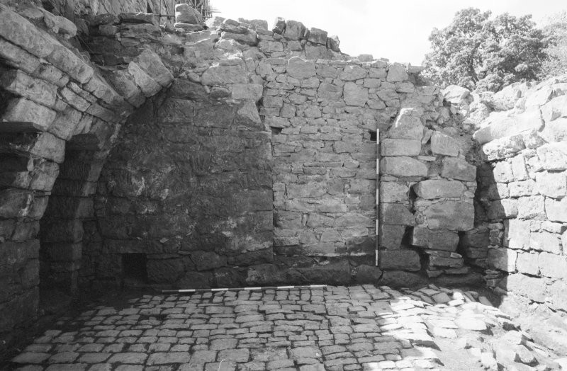 Craignethan Castle Excavations 1984 Frame 28 - The west side of the room, showing blocked doorway in west wall and cobbled floor - from east