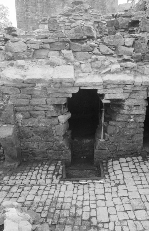 Craignethan Castle Excavations 1984 Frame 4 - The fireplace and ash-pit in south wall of tower basement - from north