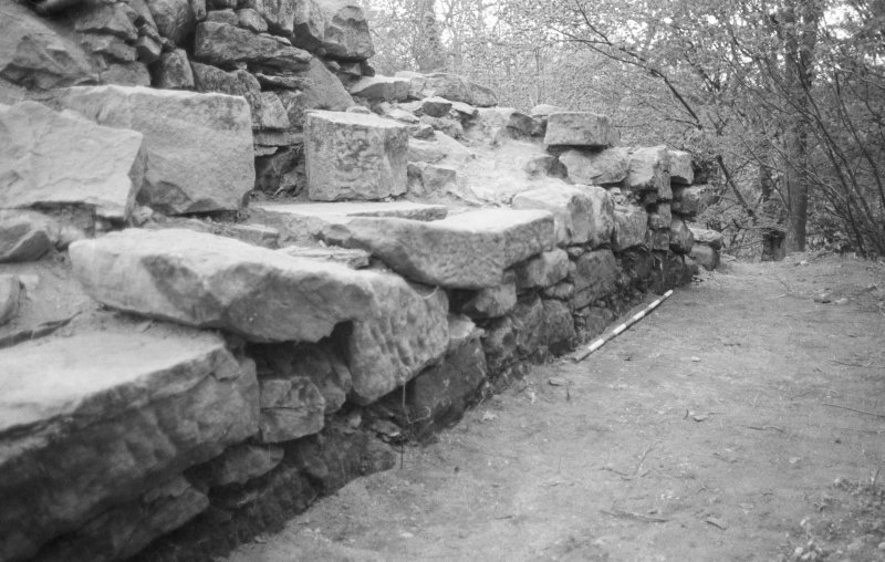 Craignethan Castle Excavations 1984 Frame 35 - View along outside face of east wall of tower - from south-east