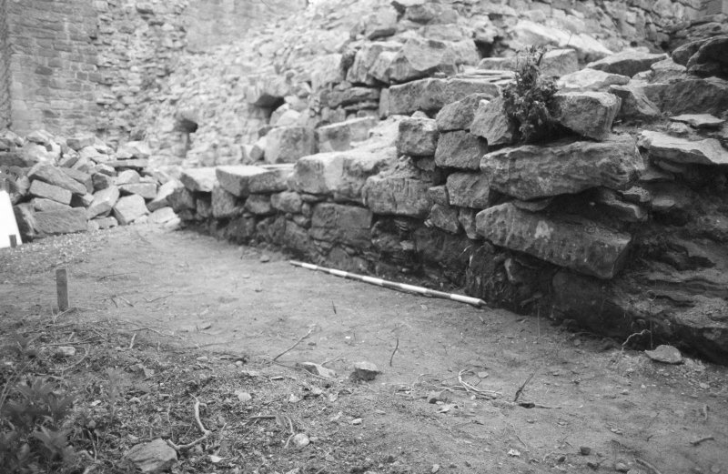 Craignethan Castle Excavations 1984 Frame 36 - View along outside face of east wall of tower - from north-east