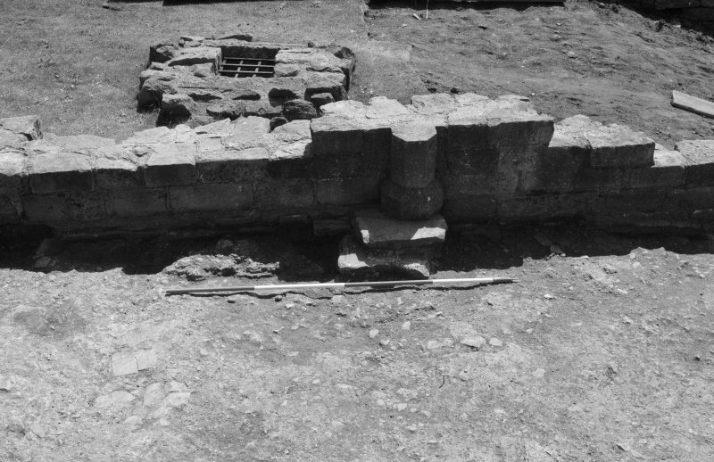 Jedburgh Abbey excavation archive Frame 8: Area 1: South end of Room 5 after removal of topsoil from against its S wall. From N.