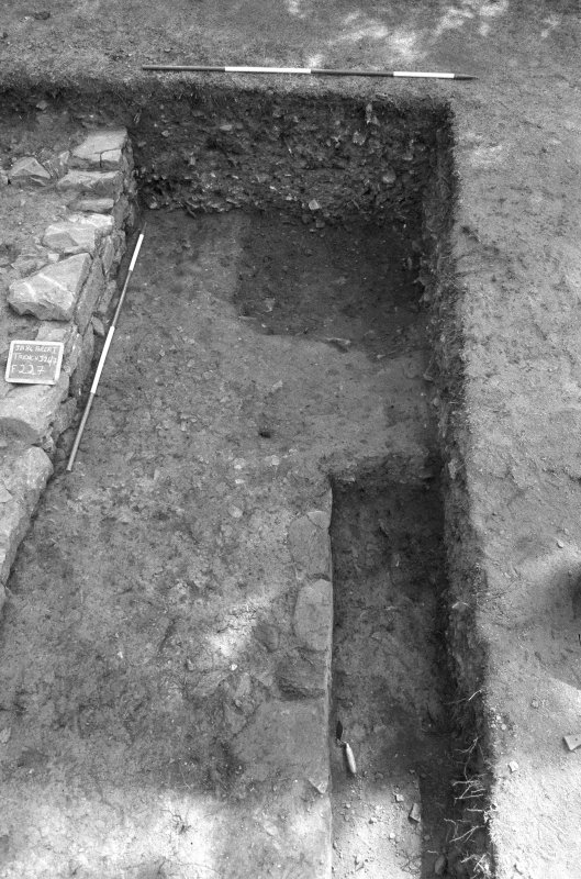 Jedburgh Abbey excavation archive Frame 2: Area 1: Trench J after removal of 275, showing circular pit 292 cutting 274. From W.