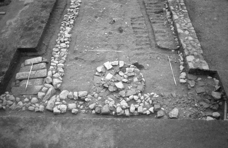 Jedburgh Abbey excavation archive Frame 12: Area 3: Trench Q: N end of trench. Column base 1215. From N.