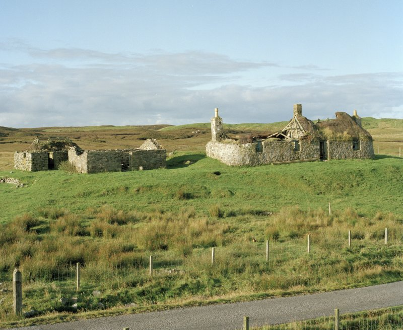 Thatched house and outbuildings, view from N