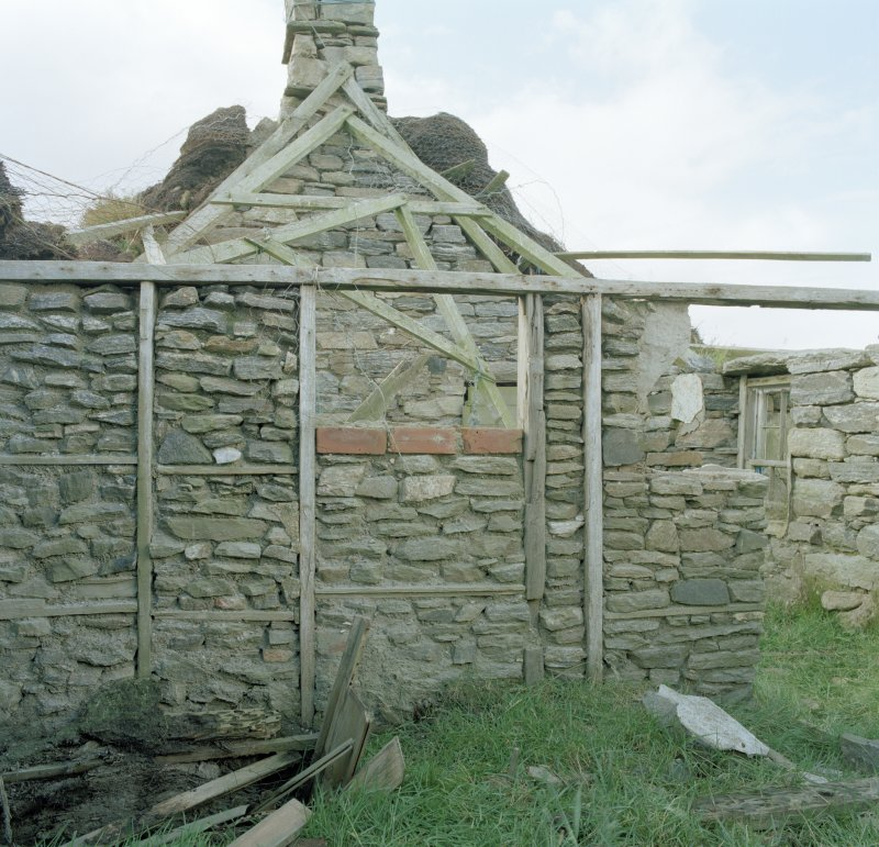 Thatched house, detail of internal partition wall with stone infill