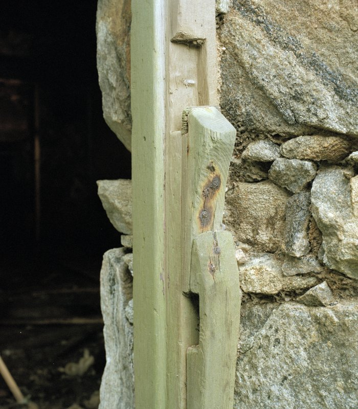 Thatched house, detail of wooden door latch and lock