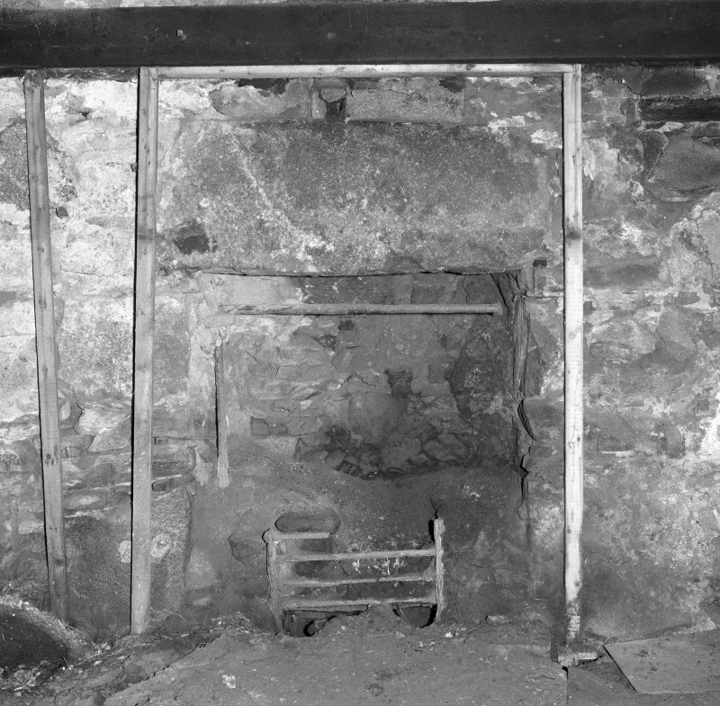 Interior: Thatched house, detail of fireplace