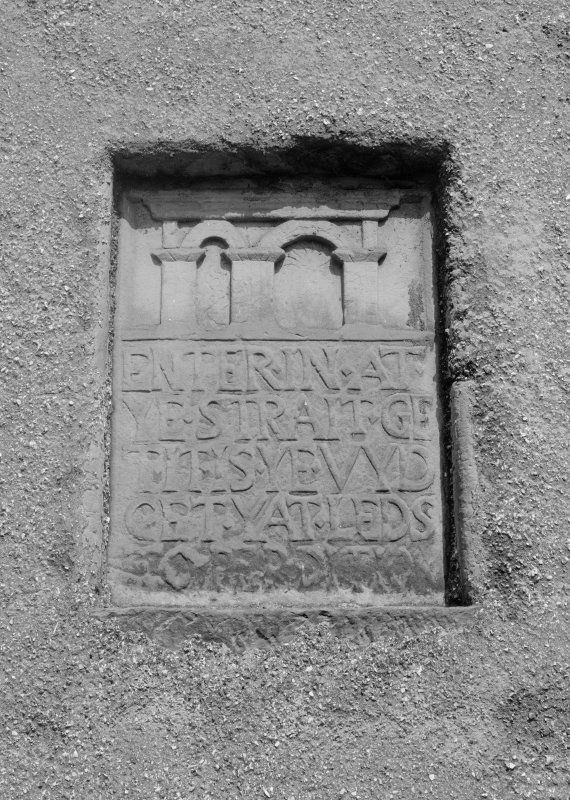 View of inscribed panel set in wall of St Adrian's Church, Anstruther Wester.