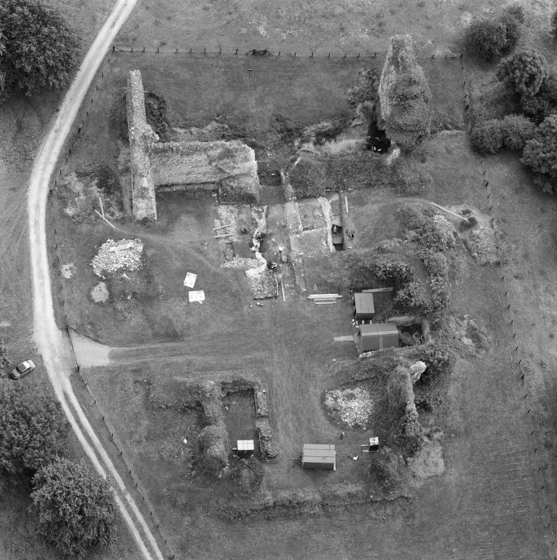 Oblique aerial view centred on Lochmaben Castle showing excavations in progress.