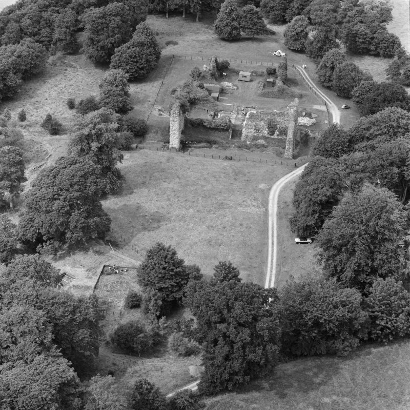 Oblique aerial view centred on Lochmaben Castle from S, showing excavations in progress.