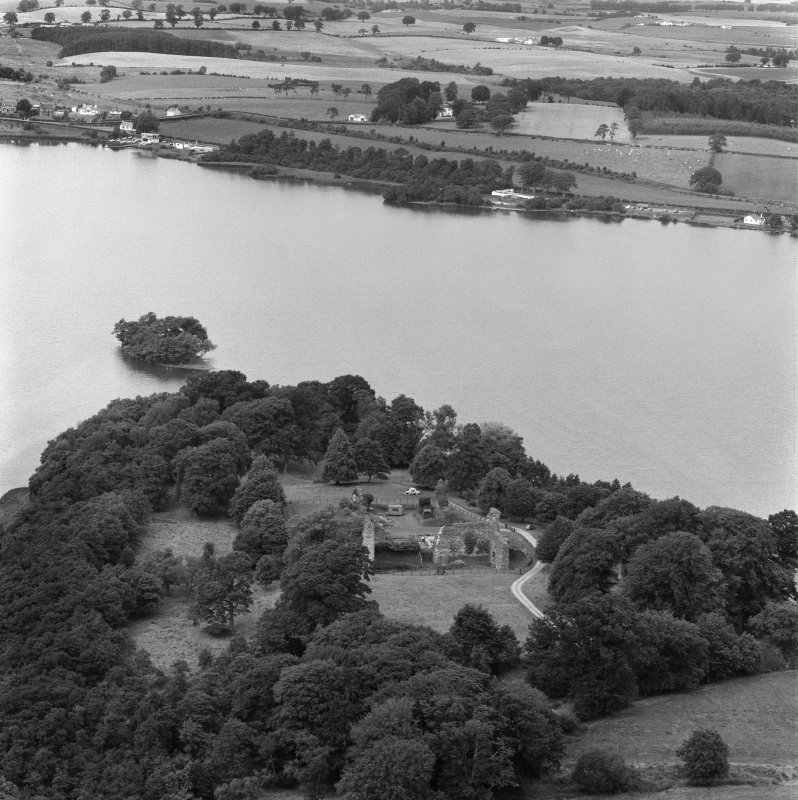 Oblique aerial view of Lochmaben Castle from S, showing excavations in progress.