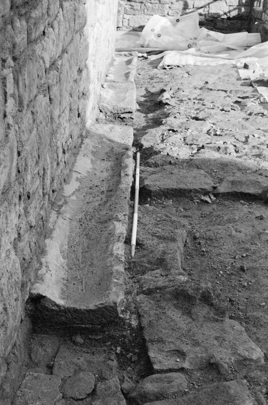 Craignethan Castle Excavations 1993-1995 Frame 34 - Segments of V-shaped drain F308 - from south